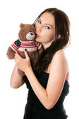 Young woman kissing teddy-bear — Stock Photo