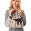 Portrait of attractive blonde with a handbag — Stock Photo