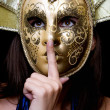 Young woman in a Venetian mask — Stock Photo