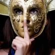 Young woman in a Venetian mask — Stock Photo #5634172