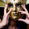 Girl in a Venetian mask — Stock Photo