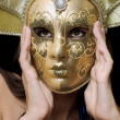 Portrait of girl in a Venetian mask — Stock Photo