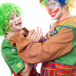 Clown tries to strangle a female clown — Stock Photo