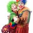 A couple of smiling clowns dancing — Stock Photo