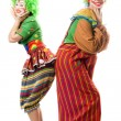 Two smiling clowns are back to back — Stock Photo