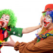 Clowns are fighting for an apple — Stock Photo