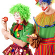 Inequity in the world of clowns - Stock Photo
