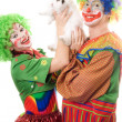 Two playful clown with a white rabbit — Stock Photo