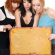Women looking at vintage board — Stock Photo