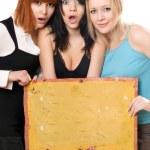 Surprised women taking a board — Stock Photo #5634469
