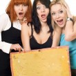 Excited women holding a board — Stock Photo