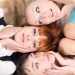 Stock Photo: Three disturbed women touching their cheeks