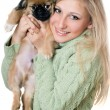 Young blonde with a puppy — Stock Photo