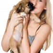 Woman kissing her puppy — Stock Photo