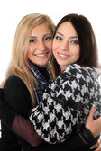 Portrait of two attractive girls embracing — Stock Photo