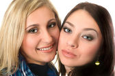 Closeup portrait of beautiful smiling young women — Stock Photo