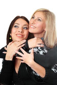 Portrait of two attractive young women embracing — Stock Photo