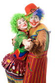 A couple of happy clowns dancing — Stock Photo