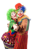 A couple of smiling clowns dancing — Foto de Stock