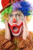 Portrait of a terrified clown — Stock Photo