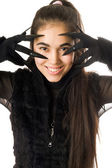 Portrait of smiling young woman in gloves — Stock Photo