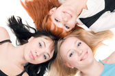 Three young cheerful women — Stockfoto