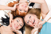 Three young playful women — Stockfoto