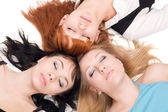 Three women with closed eyes — Stockfoto