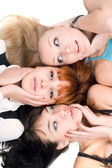 Three disturbed women touching their cheeks — Stockfoto