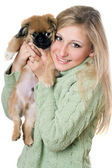 Young blonde with a puppy — Stockfoto