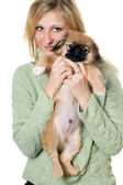 Young woman with a pekinese — Stock Photo