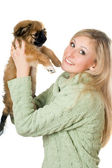 Young woman playing with a pekinese — Stock Photo