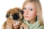 Pretty woman with a pekinese — Stock Photo