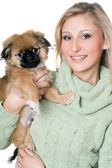 Smiling woman with a pekinese — Stock Photo