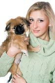 Pretty blonde with a pekinese — Stock Photo