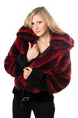 Sexy blond woman in a fur jacket — Stock Photo