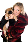Young woman holding a pekinese — Stock Photo