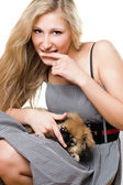 Portrait of young woman with puppy — Stock Photo