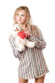 Thoughtful blonde holding teddy bear — Stock Photo