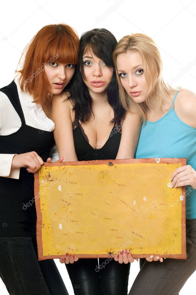 Three young frightened women taking vintage yellow board. Isolated — Stock Photo #5634467