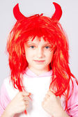 Girl in a red wig with small horns — Stock Photo
