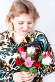 Pretty woman with a bunch of flowers — Stock Photo
