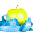 Apple and tape of measurements. — Stock Photo #5687799