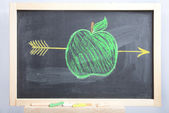 Apple and arrow on a schoolboard — Stock Photo