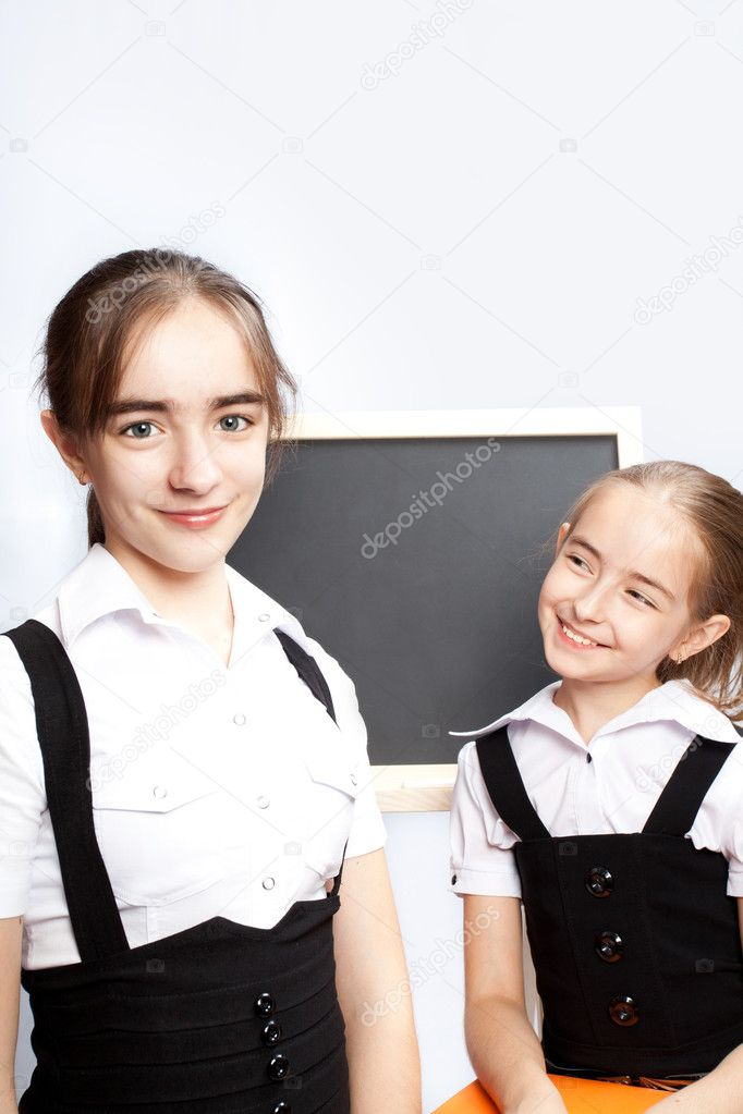 Two schoolgirls about a schoolboard — Stock Photo #6676956
