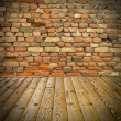 Pine floor and brick wall — Photo
