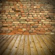 Pine floor and brick wall - Stock Photo