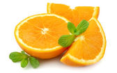 Juicy orange with mint — Stock Photo
