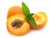 Ripe apricots with mint — Stock Photo