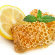 Honey honeycombs with lemon - Stock Photo